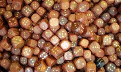Wooden dice illustrate the idea of BUNCO night